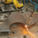 Torch cutting and beveling on a thick steel plate with a robot